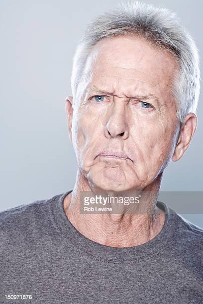Portrait of angry senior man, studio shot