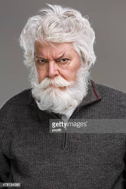 Portrait of angry senior man with white beard and mustache