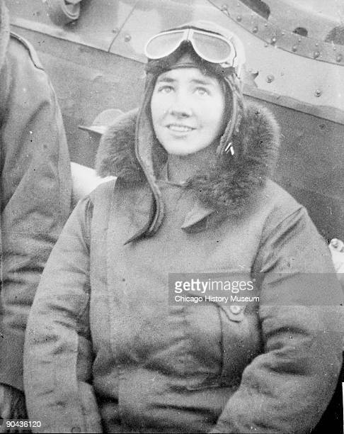 Portrait of Anne Morrow Lindbergh pioneering aviator and wife of Charles Lindbergh sitting at the side of an airplane on the ground in Chicago...
