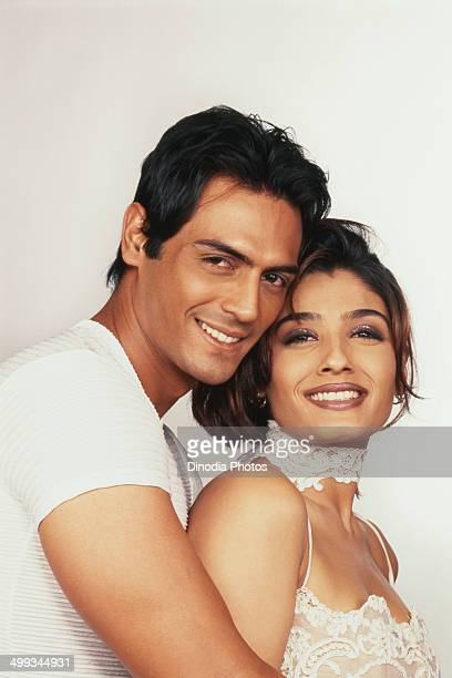 Portrait of Arjun Rampal and Raveena Tandon