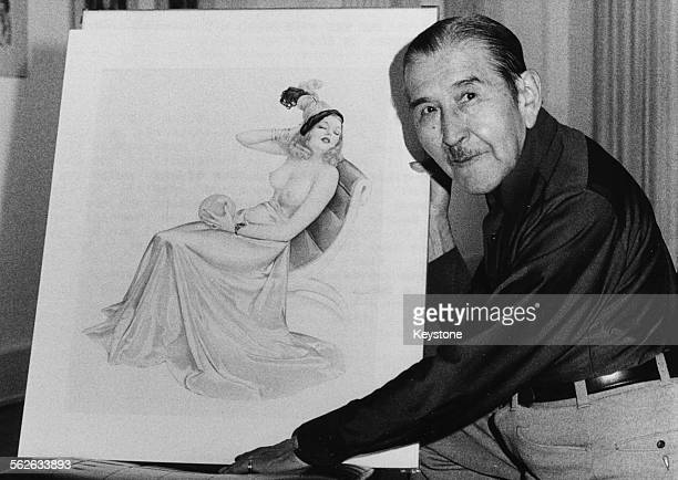 Portrait of artist Alberto Vargas with one of his original 'pin up girl' illustrations during his stay in Bonn Germany circa 1970