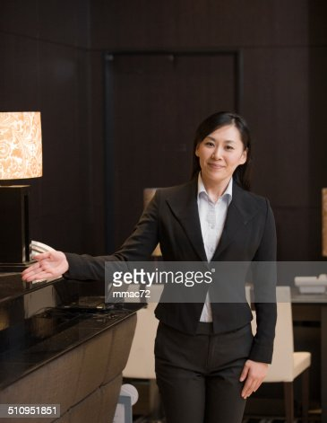Portrait of Asian Concierge in Hotel