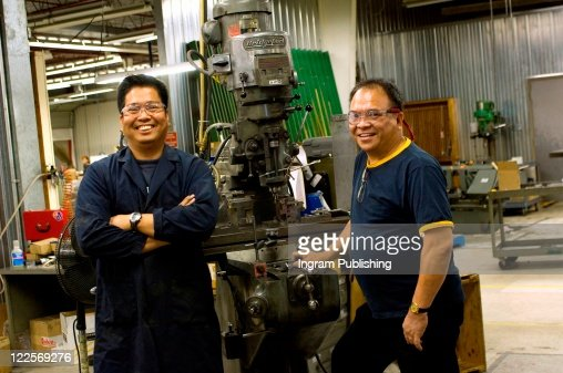 Portrait of Asian machinists in work shop. : Foto stock