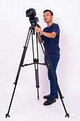 Studio Shot Of Asian Man Against White Background