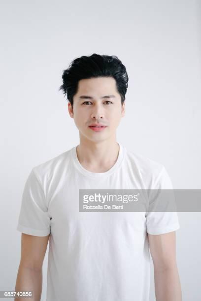Portrait of asian man, white background