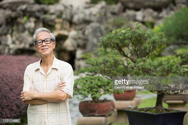 Portrait of Asian man with Bonsai tree