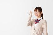 portrait of asian school girl on white background
