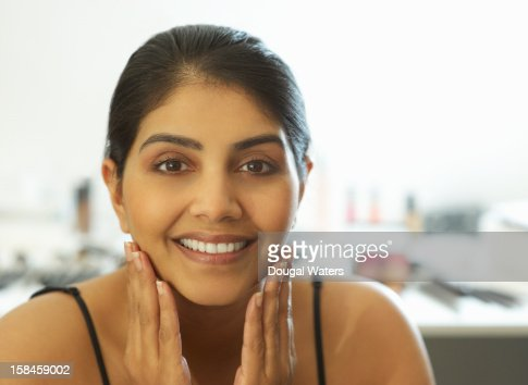 Portrait of Asian woman touching hands to face. : Stock Photo
