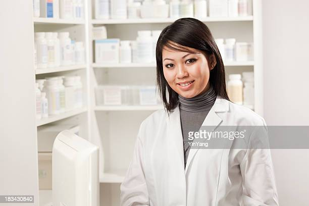 Portrait of Asian Young Woman Pharmacist in Drug Store Pharmacy