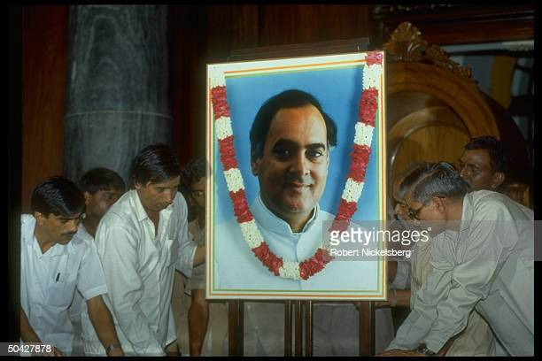 Portrait of assassinated Congress I Pres PM cand former PM Rajiv Gandhi adorning party mtg hall during choosing of his successor