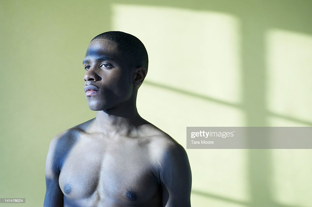 portrait of athletic young man with bare chest : Stock Photo