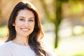 Portrait Of Attractive Hispanic Woman In Countryside Smiling To Camera