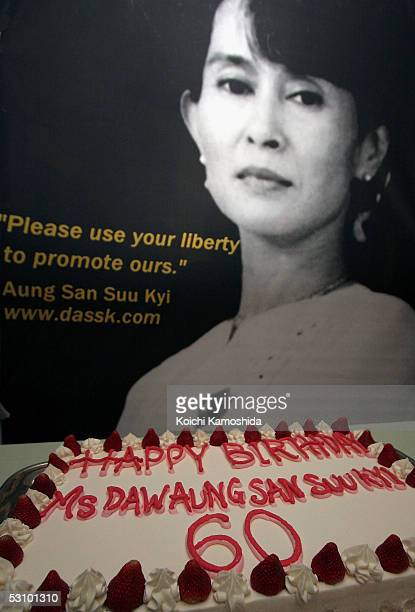 A portrait of Aung San Suu Kyi next to a birthday cake during Myanmar's opposition leader Aung San Suu Kyi's 60th birthday celebrations on June 19...