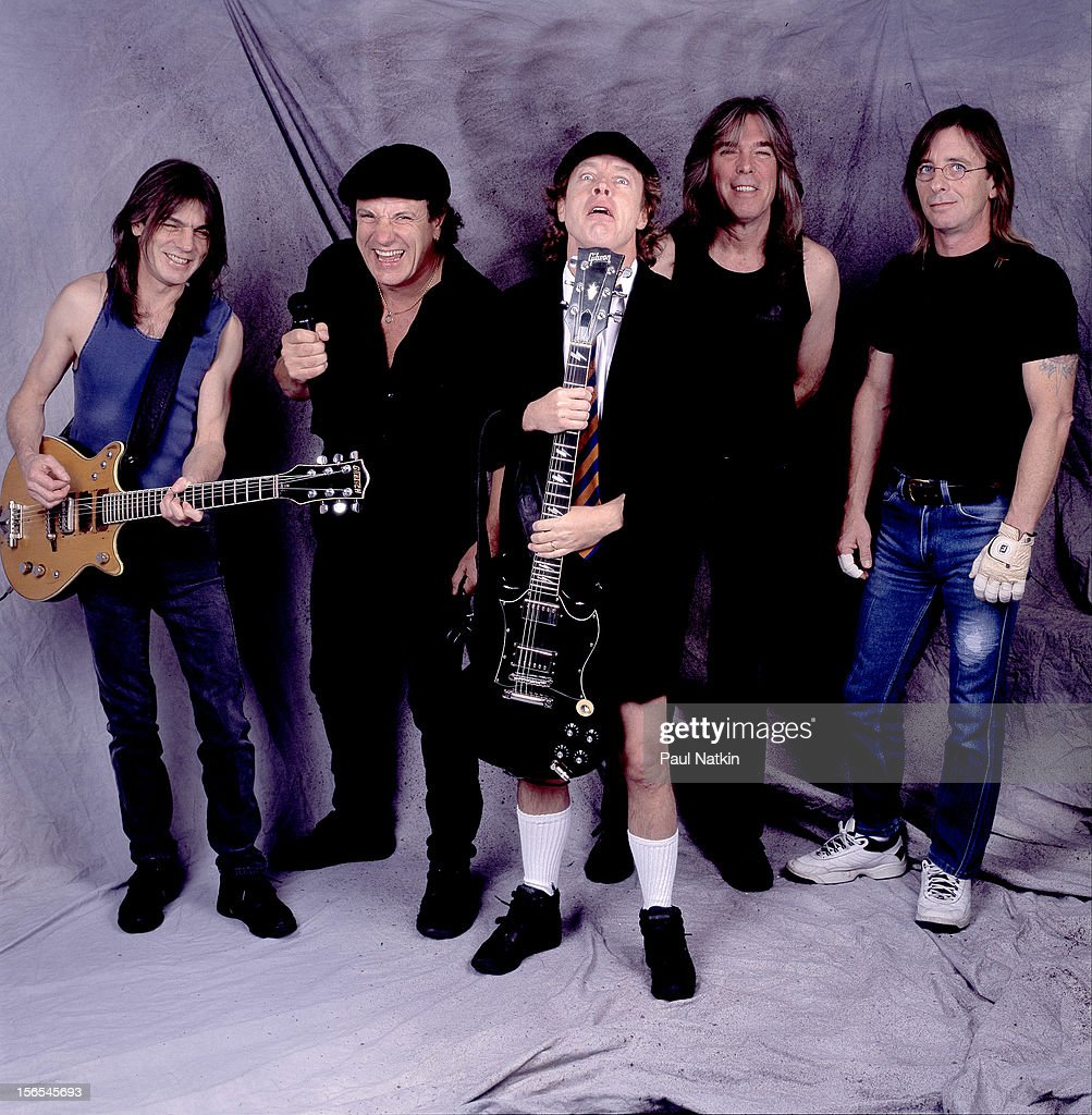Portrait of Australian rock group AC/DC backstage at the United Arena, Chicago, Illinois, April 8, 2001. Pictured are, from left, Malcolm Young, Brian Johnson, Angus Young, Cliff Williams, and Phil Rudd.