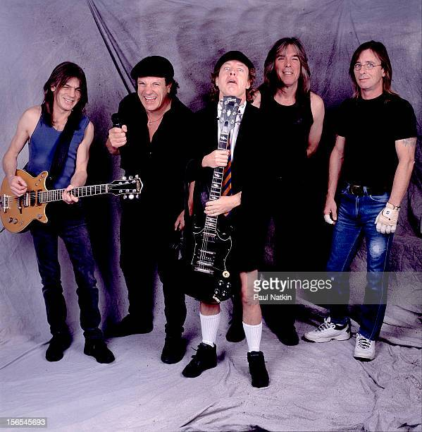 Portrait of Australian rock group AC/DC backstage at the United Arena Chicago Illinois April 8 2001 Pictured are from left Malcolm Young Brian...