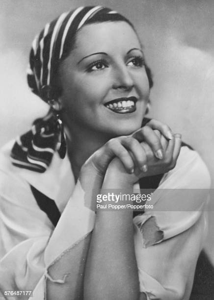 Portrait of Austrian actress Jenny Jugo wearing a headscarf circa 1936