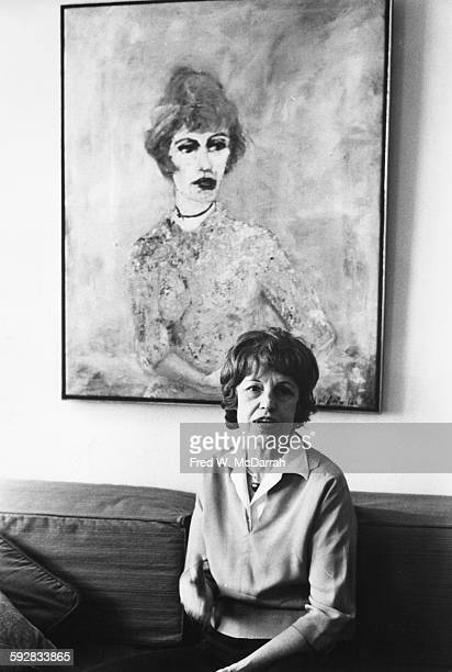 Portrait of Austrian actress Lotte Lenya as she sits on a couch beneath a painting of herself New York New York November 16 1972