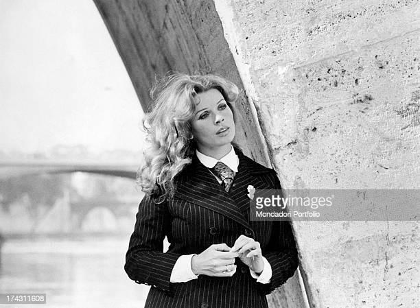 Portrait of Austrian actress Santa Berger wearing a pinstripe man's suit Rome 1971