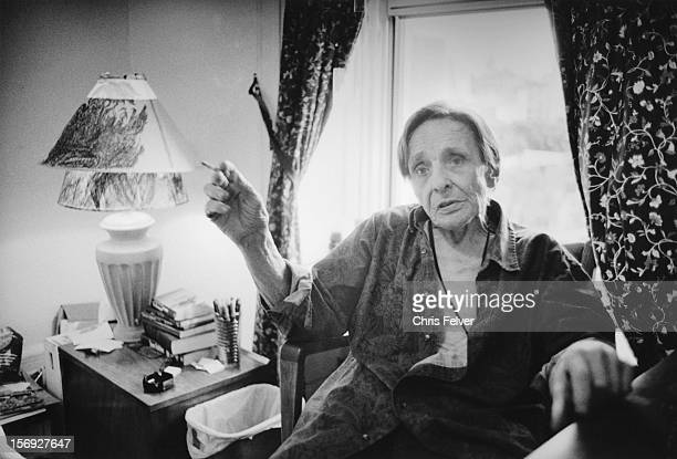 Portrait of author Herbert Huncke as he smokes a cigarette in his room at the Chelsea Hotel New York New York 1995