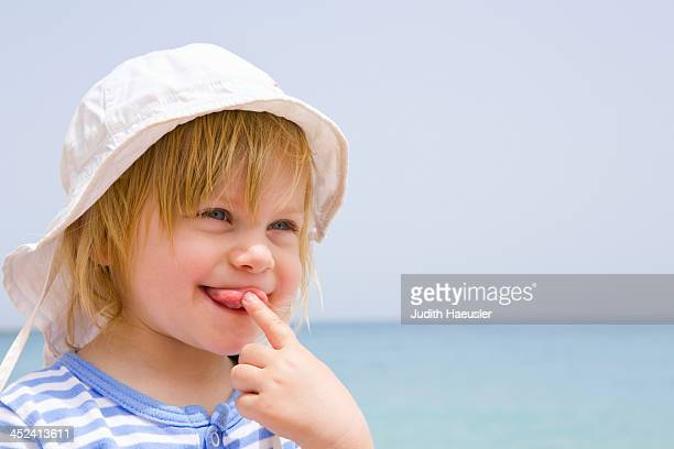 Portrait of baby at beach with tongue out