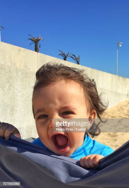Portrait Of Baby Boy Against Sky At Beach