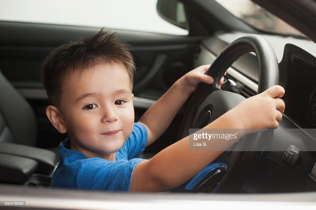Portrait of baby boy (12-23 months) in car
