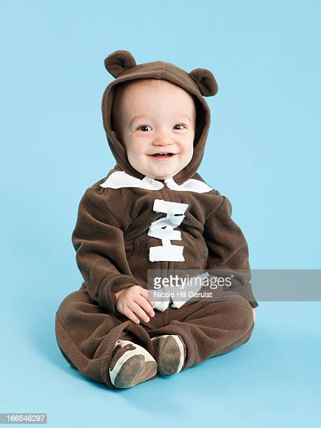 Portrait of baby boy (12-17 months) in football costume