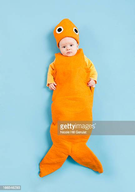 Portrait of baby boy (2-5 months) in goldfish costume
