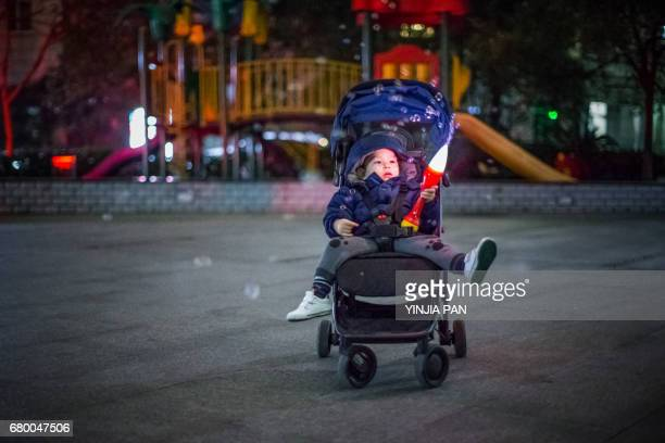 Portrait of baby boy playing bubble wand in the amusement park