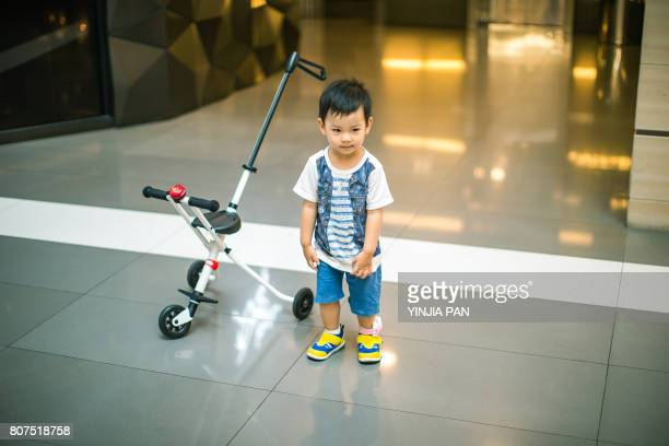 Portrait of baby boy standing in the mall
