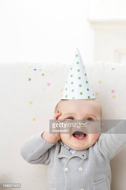 Portrait of baby boy wearing paper hat