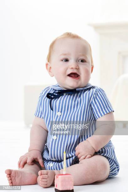 Portrait of baby boy with little birthday cake