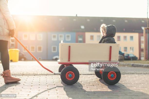 Portrait of baby driving in a big foot wagon