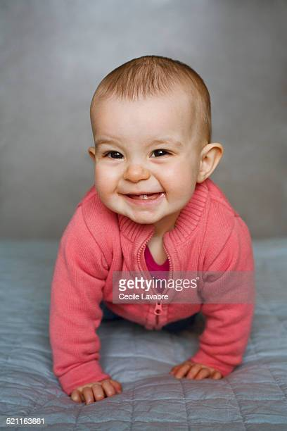 Portrait of baby girl laughing