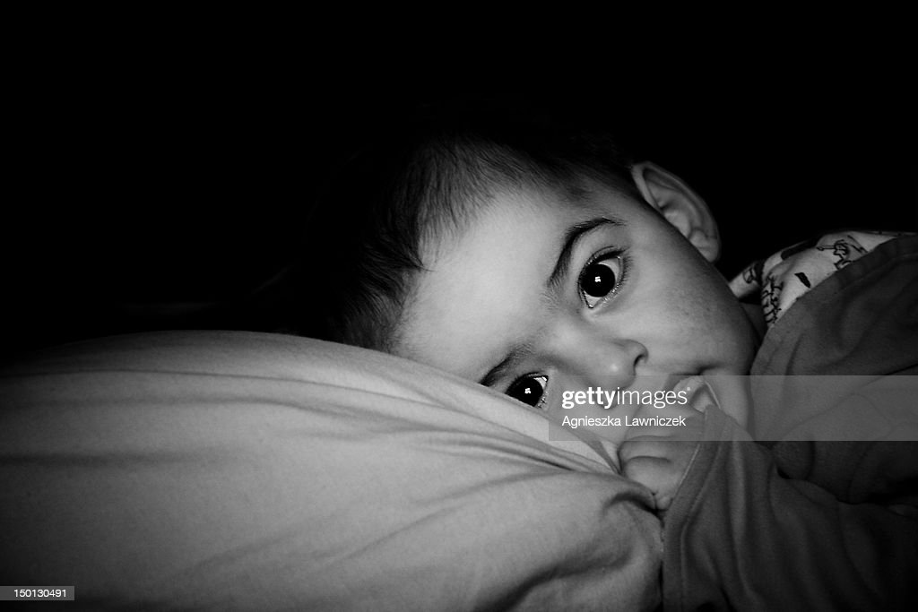 Portrait of baby girl with a pillow : Stock Photo