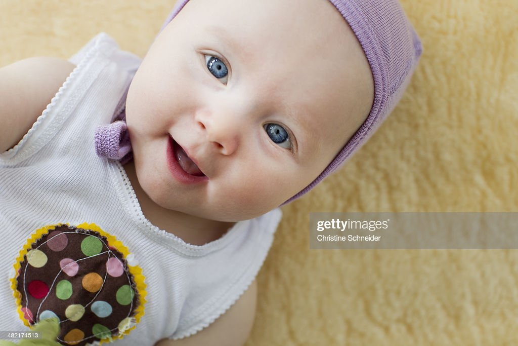 Portrait of baby girl with blue eyes : Stock Photo