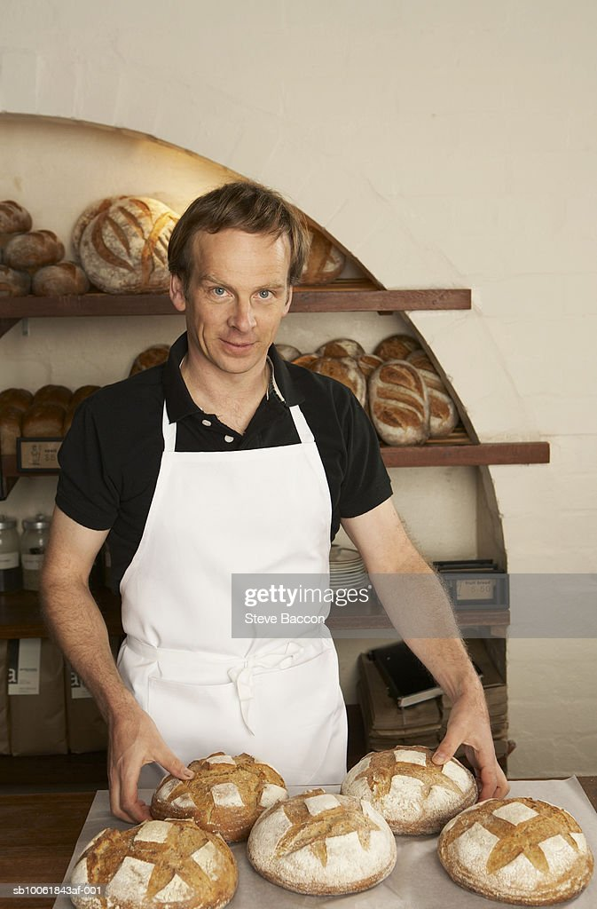 Portrait of baker presenting bread