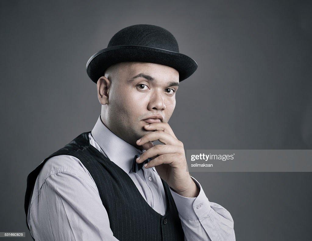 Portrait of bald man with bowler