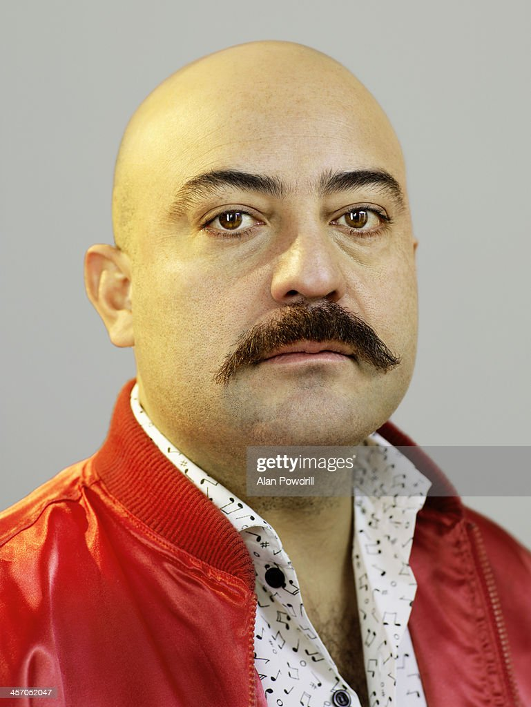 Portrait of bald man with moustache
