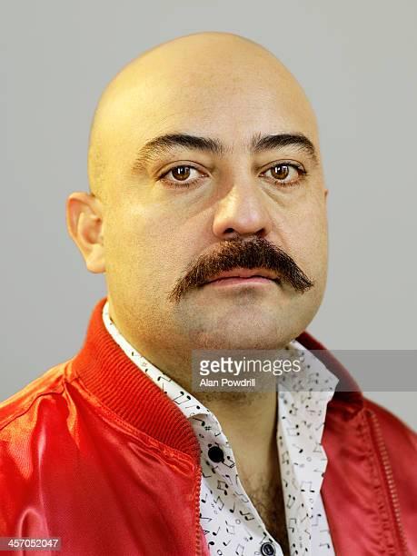 Portrait of bald man with moustache