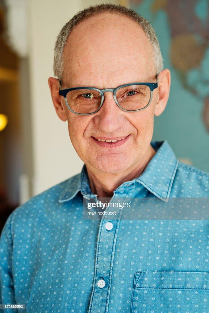 Portrait of bald senior man with glasses smiling. : Stock Photo