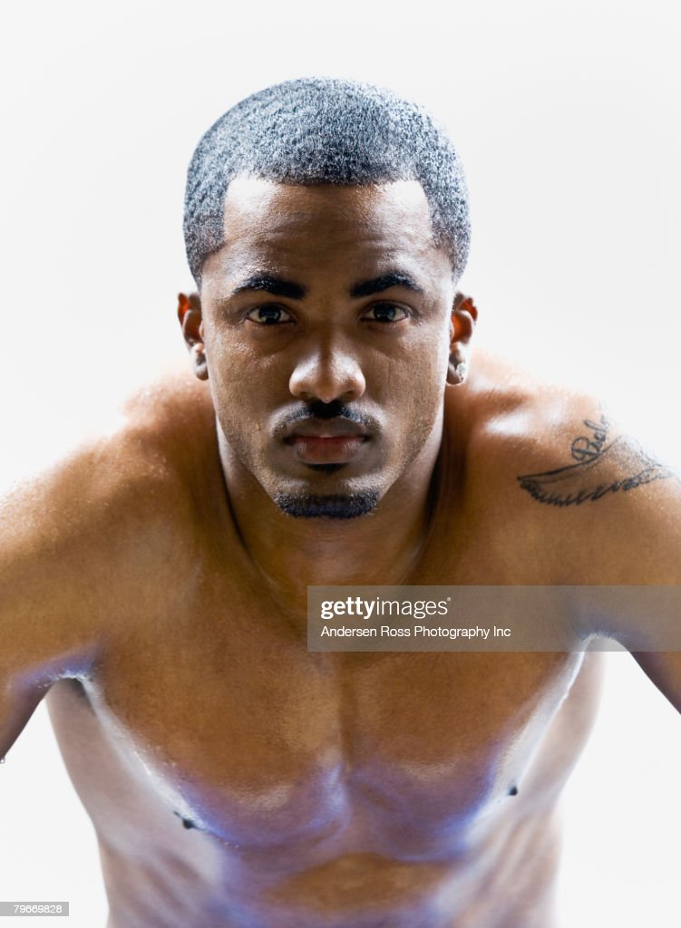 Portrait of bare-chested African American man  : Stock Photo
