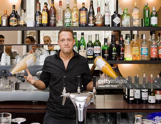Portrait of bartender spinning drinks