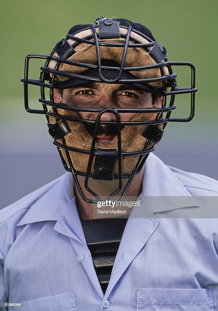 Portrait of baseball umpire wearing protective face mask.