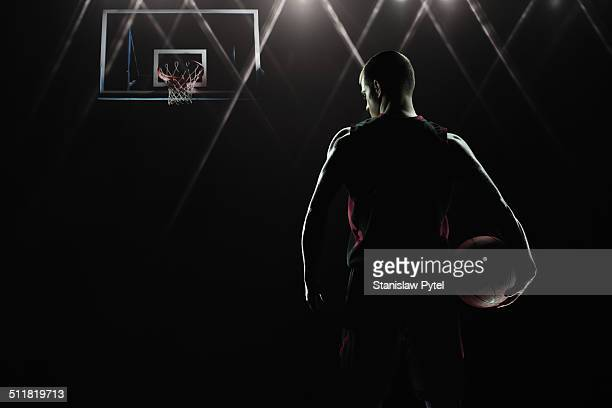 Portrait of basketball player facing basket
