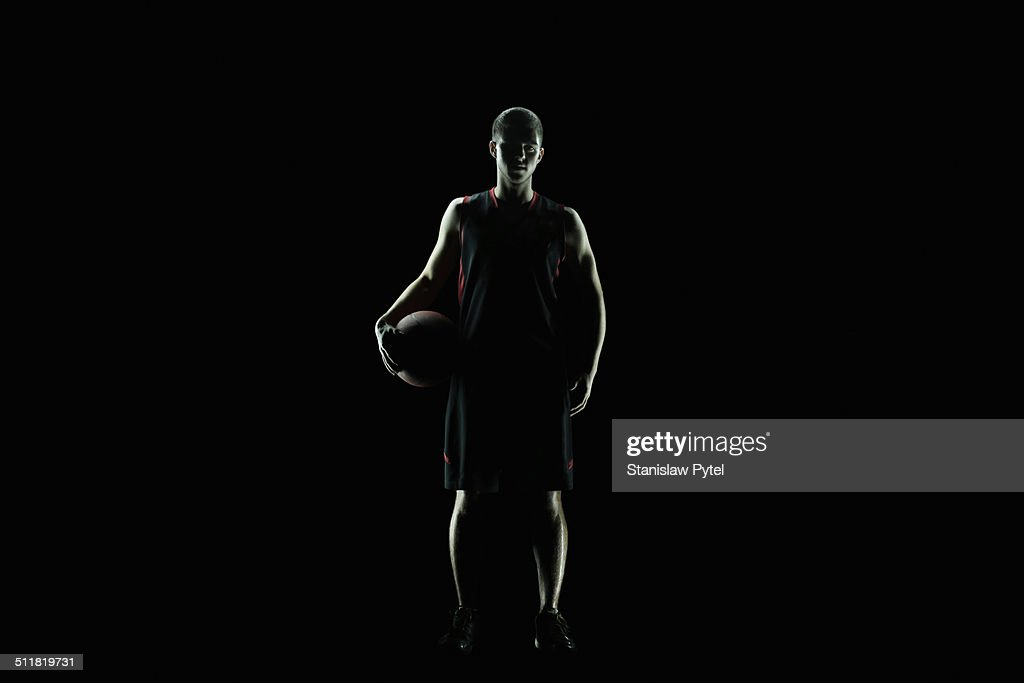 Portrait of basketball player, full body