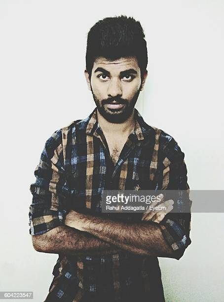 Portrait Of Bearded Confident Young Man Against White Background