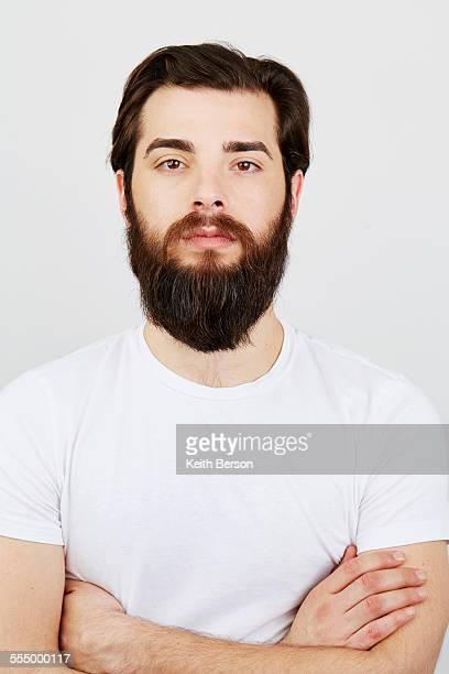Portrait of bearded man in white t-shirt