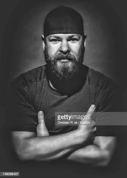 Portrait Of Bearded Man With Arms Crossed