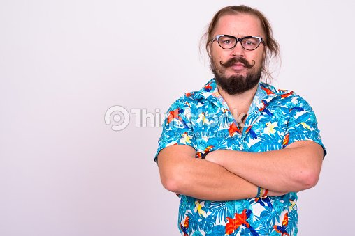 d5eab9675 Portrait of bearded man with mustache and long hair against white  background wearing Hawaiian shirt :